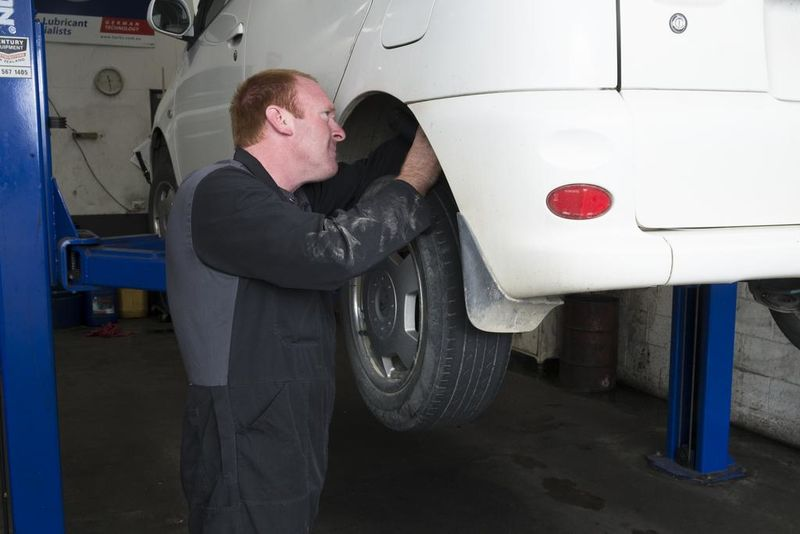 Inspecting the brake operation during a WOF.